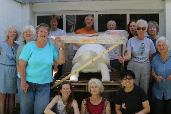 Artists with the crated turtle