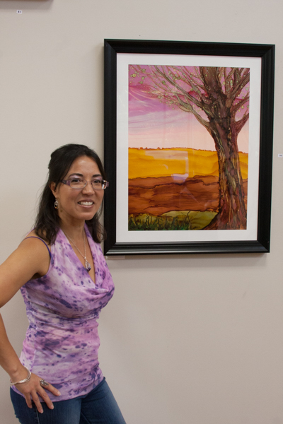 Jeanette Rodriguez with painting