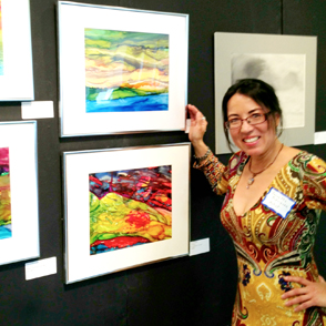 Jeanette Rodriguez with paintings